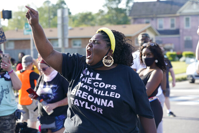 A protester yells during a protest of the shooting of Andrew Brown Jr. in Elizabeth City, N.C., Wednesday, April 28, 2021. A judge has denied requests to release body camera video in the case of Brown, a Black man who was killed by North Carolina deputies. (AP Photo/Steve Helber)