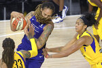Phoenix Mercury center Brittney Griner, center, fights for position between Los Angeles Sparks center Seimone Augustus (33) and forward Candace Parker, right, during the second half of a WNBA basketball game Saturday, July 25, 2020, in Ellenton, Fla. (AP Photo/Phelan M. Ebenhack)