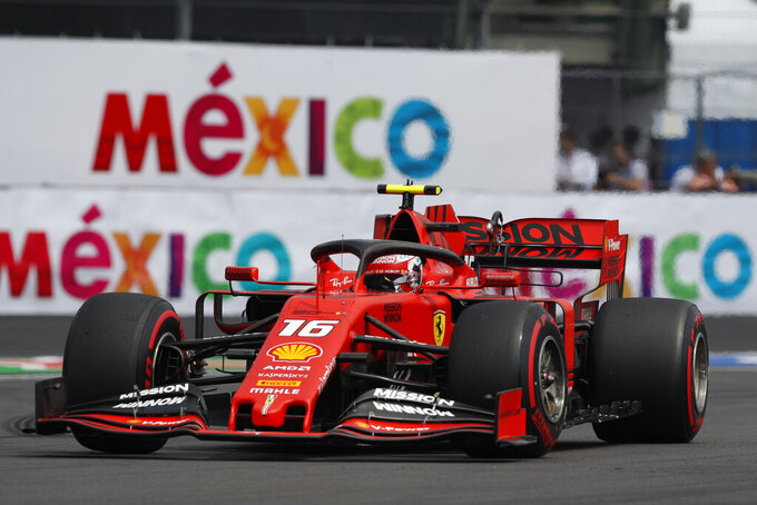 Ferrari driver Charles Leclerc, of Monaco, competes during the qualifying session for the Formula One Mexico Grand Prix auto race at the Hermanos Rodriguez racetrack in Mexico City, Saturday, Oct. 26, 2019. (AP Photo/Rebecca Blackwell)