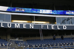 A sign bears the name Lumen Field, the new moniker of the stadium where the Seattle Seahawks NFL football team play, before the team's game against the Arizona Cardinals, Thursday, Nov. 19, 2020, in Seattle. The field name was changed because CenturyLink, the current name-rights holder, has rebranded to Lumen Technologies. (AP Photo/Lindsey Wasson)