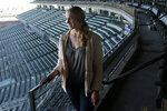San Francisco Giants coach Alyssa Nakken poses for photos at Oracle Park in San Francisco, Thursday, Feb. 6, 2020. Nakken is the first female coach on a major league staff in baseball history. (AP Photo/Jeff Chiu)