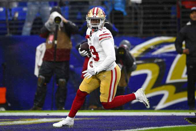 San Francisco 49ers wide receiver Deebo Samuel (19) scores a touchdown against the Baltimore Ravens in the first half of an NFL football game, Sunday, Dec. 1, 2019, in Baltimore, Md. (AP Photo/Nick Wass)