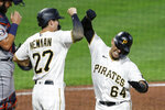 Pittsburgh Pirates' Phillip Evans (64) celebrates with Kevin Newman (27) after driving him and Bryan Reynolds in with a three run home run against the Detroit Tigers in the fifth inning of a baseball game, Friday, Aug. 7, 2020, in Pittsburgh. (AP Photo/Keith Srakocic)