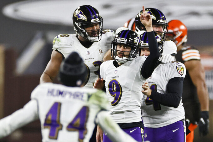 Baltimore Ravens kicker Justin Tucker (9) celebrates after kicking a field goal during the second half of an NFL football game against the Cleveland Browns, Monday, Dec. 14, 2020, in Cleveland. The Ravens won 47-42. (AP Photo/Ron Schwane)