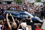 The car carrying the remains of Emiliano Sala leaves Progreso, Argentina, Saturday, Feb. 16, 2019. The Argentina-born forward died in an airplane crash in the English Channel last month when flying from Nantes in France to start his new career with English Premier League club Cardiff. (AP Photo/Natacha Pisarenko)