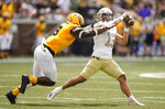 Kennesaw State defensive back Welton Spottsville (5) pressures Georgia Tech quarterback Jordan Yates (13) during the first half of an NCAA college football game, Saturday, Sept. 11, 2021, in Atlanta. (AP Photo/Brynn Anderson)