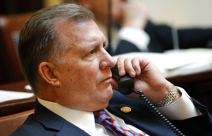 FILE- In this Jan. 31, 2018, file photo, shows Provo Republican Sen. Curt Bramble on the Senate floor at the Utah State Capitol, in Salt Lake City. A law requiring abortion and medical providers to cremate or bury fetal remains passed the state Senate Tuesday, Feb. 11, 2020, in Utah, one of several states considering similar measures that abortion-rights advocates say stigmatize the procedure.
