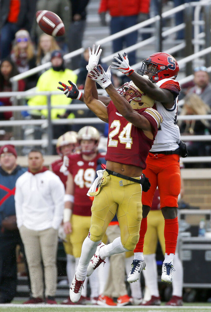 Boston College defensive back Taj-Amir Torres (24) breaks up a pass intended for Syracuse wide receiver Nykeim Johnson (82) during the second half of an NCAA college football game, Saturday, Nov. 24, 2018, in Boston. (AP Photo/Mary Schwalm)