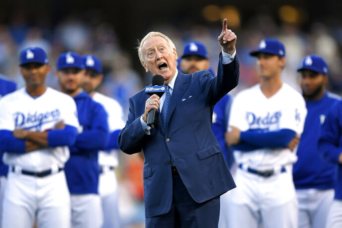 FILE - In this May 3, 2017, file photo, Los Angeles Dodgers broadcaster Vin Scully speaks during his induction into the team's Ring of Honor prior to a baseball game between the Dodgers and the San Francisco Giants, in Los Angeles. Retired Baseball Hall of Fame broadcaster Scully turned 93 on Sunday, Nov. 29, 2020, and marked the day by watching football. (AP Photo/Mark J. Terrill, File)