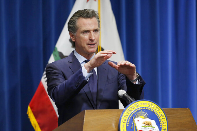 FILE - In this May 14, 2020, file photo, California Gov. Gavin Newsom discusses his revised 2020-2021 state budget during a news conference in Sacramento, Calif. The California Senate's plan to cover a projected budget deficit rejects Gov. Gavin Newsom's proposed cuts to public education and health care programs. Newsom's plan would cut funding for public schools by about $8 billion. The Senate's plan would restore $2.7 billion of those cuts, the rest being deferred to future years. (AP Photo/Rich Pedroncelli, Pool, File)