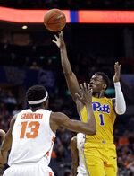 Pittsburgh's Xavier Johnson (1) shoots against Syracuse's Paschal Chukwu (13) during the first half of an NCAA college basketball game in the Atlantic Coast Conference tournament in Charlotte, N.C., Wednesday, March 13, 2019. (AP Photo/Nell Redmond)