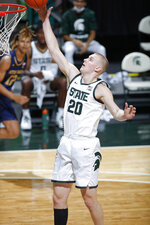 Michigan State's Joey Hauser pulls down a rebound against Notre Dame during the first half of an NCAA college basketball game, Saturday, Nov. 28, 2020, in East Lansing, Mich. (AP Photo/Al Goldis)