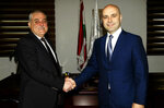 FILE - In this Feb. 15, 2019 file photo, released by the Lebanese Government, Lebanese Health Minister Jamil Jabak, who was chosen by Hezbollah, left, shakes hands with outgoing minister Ghassan Hasbani, during a handover ceremony, in Beirut, Lebanon. U.S. Secretary of State Mike Pompeo's visit to Lebanon this week is expected to underscore the Trump administration's displeasure with Hezbollah's growing influence in Lebanese politics. The Iranian-backed group wields more power than ever in the country's Cabinet and parliament. (Dalati Nohra/Lebanese Government via AP, File)