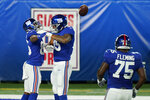 New York Giants wide receiver Darius Slayton (86), far left, celebrates with teammates after scoring touchdown against the Pittsburgh Steelers during the second quarter of an NFL football game Monday, Sept. 14, 2020, in East Rutherford, N.J. (AP Photo/Seth Wenig)