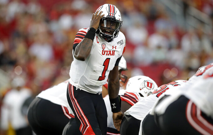Utah quarterback Tyler Huntley calls out to teammates at the line of scrimmage, against Southern California during the first half of an NCAA college football game Friday, Sept. 20, 2019, in Los Angeles. (AP Photo/Marcio Jose Sanchez)