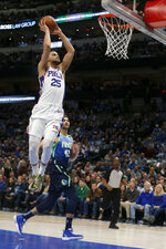 Philadelphia 76ers guard Ben Simmons (25) prepares to dunk in front of Dallas Mavericks forward Maxi Kleber (42) during the first half of an NBA basketball game in Dallas, Saturday, Jan 11, 2020. (AP Photo/Michael Ainsworth)