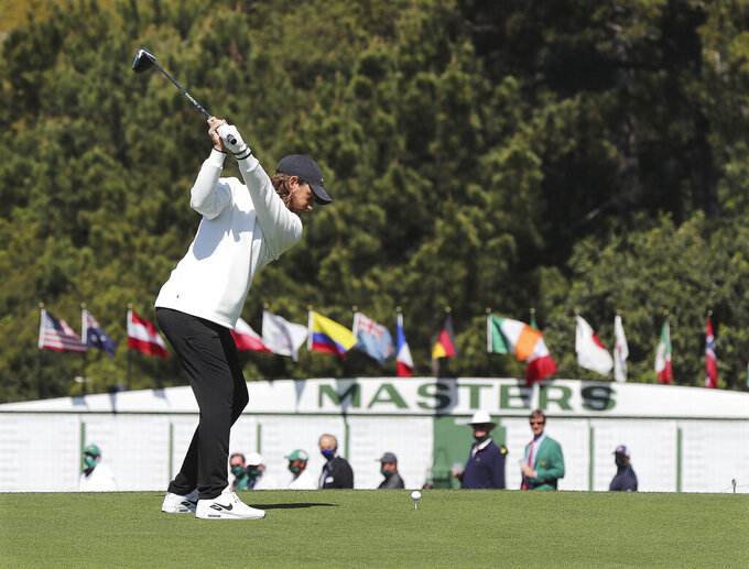 Tommy Fleetwood tees off on the first hole to begin a practice round for the Masters at Augusta National Golf Club on Sunday, April 4, 2021, Augusta, Ga. (Curtis Compton/Atlanta Journal-Constitution via AP)