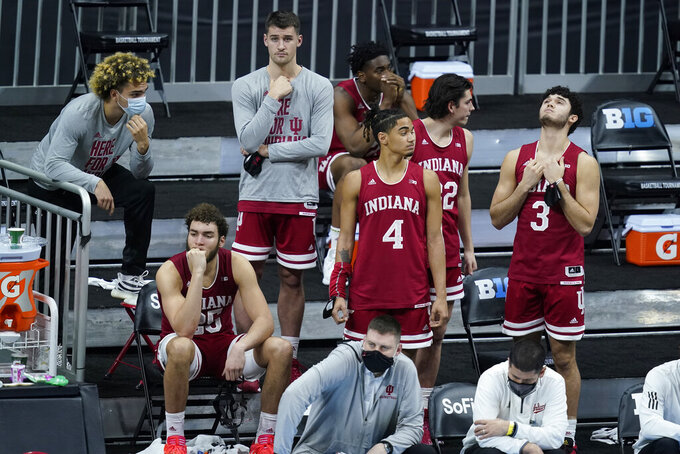 Indiana players watch in the final seconds of an NCAA college basketball game against Rutgers at the Big Ten Conference tournament, Thursday, March 11, 2021, in Indianapolis. Rutgers won 61-50. (AP Photo/Darron Cummings)