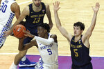 Kentucky's Terrence Clarke, left, passes away from the defense of Notre Dame's Cormac Ryan during the second half of an NCAA college basketball game in Lexington, Ky., Saturday, Dec. 12, 2020. Notre Dame won 64-63. (AP Photo/James Crisp)