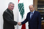 In this photo released the Lebanese Presidency press office, Lebanese president Michel Aoun, right, shakes hands with Gen. Frank McKenzie, the head of US Central Command, at the presidential palace, in Baabda, east of Beirut, Lebanon, Wednesday, July 8, 2020. McKenzie is in Lebanon for one day visit to meet with senior Lebanese political and defense leaders, including representatives of the Ministry of Defense and the Lebanese Armed Forces. (Lebanese Presidency press office via AP)