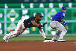 Pittsburgh Pirates' Starling Marte (6) calls for time after stealing second base past Chicago Cubs shortstop Javier Baez in the fourth inning of a baseball game, Friday, Aug. 16, 2019, in Pittsburgh. (AP Photo/Keith Srakocic)