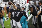 Las Vegas Raiders quarterback Derek Carr (4) celebrates after scoring a touchdown against the Miami Dolphins during the first half of an NFL football game, Saturday, Dec. 26, 2020, in Las Vegas. (AP Photo/Steve Marcus)
