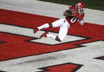 Rutgers defensive back Christian Izien (0) intercepts a pass in the end zone during the second quarter of an NCAA college football game against Nebraska, Friday, Dec. 18, 2020, in Piscataway, N.J. (Andrew Mills/NJ Advance Media via AP)