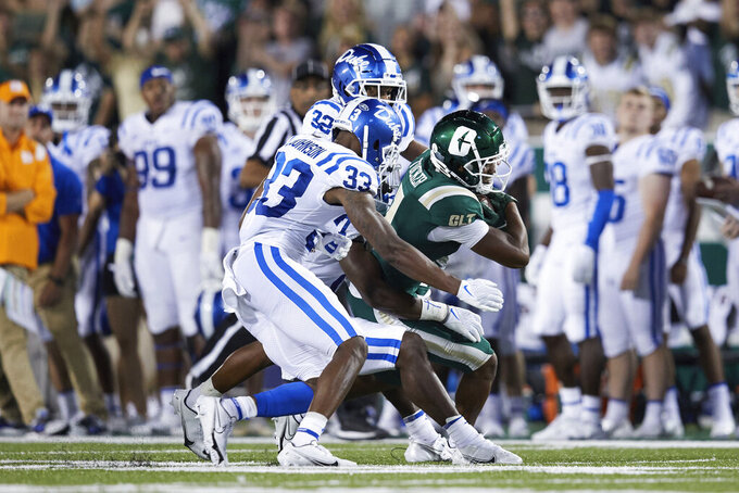 Charlotte 49ers wide receiver Victor Tucker (1) is tackled by Duke Blue Devils safety Da'Quan Johnson (17), cornerback Leonard Johnson (33), and safety Jalen Alexander (32) during an NCAA football game on Friday, Sept. 3, 2021, in Charlotte, N.C. (AP Photo/Brian Westerholt)