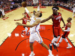 Oklahoma City Thunder forward Darius Bazley, center, shoots as Houston Rockets forward Danuel House Jr. (4) defends during the second half of an NBA basketball game, Monday, Oct. 28, 2019, in Houston. (AP Photo/Eric Christian Smith)