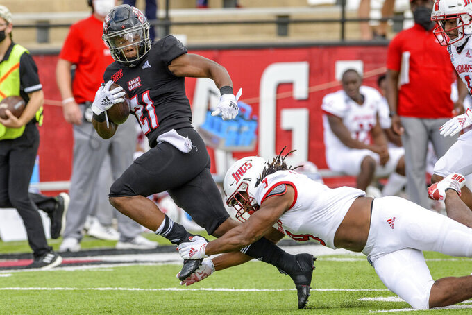 Louisiana-Lafayette running back Chris Smith (21) makes a big gain against South Alabama linebacker Kelvin Johnson (9) during the first half of an NCAA college football game in Lafayette, La., Saturday, Nov. 14, 2020. (AP Photo/Matthew Hinton)