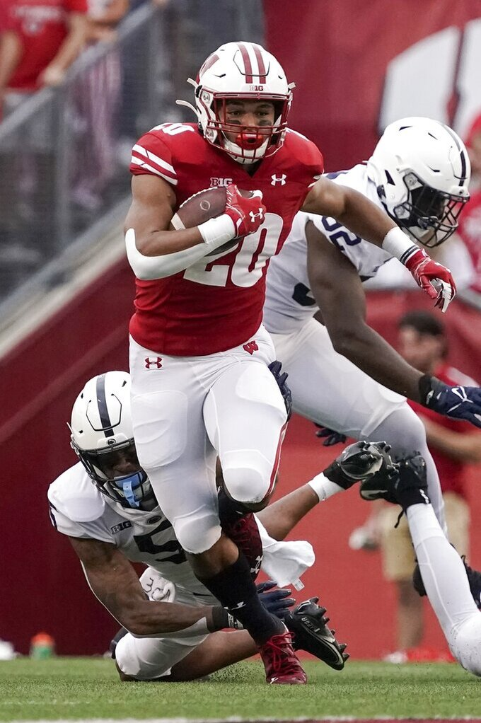 Wisconsin's Isaac Guerendo runs during the first half of an NCAA college football game against Penn State Saturday, Sept. 4, 2021, in Madison, Wis. (AP Photo/Morry Gash)