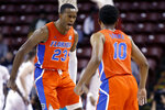 Florida's Scottie Lewis (23) celebrates with Noah Locke (10) after forcing Xavier to call a timeout in the first half of an NCAA college basketball game during the finals of the Charleston Classic, Sunday, Nov. 24, 2019, in Charleston, S.C. (AP Photo/Mic Smith)