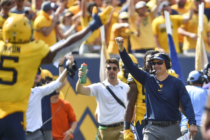 West Virginia head coach Neal Brown reacts during a play against Virginia Tech Hokies in the second half of  an NCAA college football game in Morgantown, W.Va., Saturday, Sep. 18, 2021. (AP Photo/William Wotring)