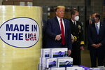 President Donald Trump participates in a tour of Owens & Minor Inc., a medical supply company, Thursday, May 14, 2020, in Allentown, Pa. (AP Photo/Evan Vucci)