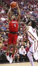 Louisville's Khwan Fore attempts to shoot over the defense of Florida State's Terance Mann, right, in the first half of an NCAA college basketball game Saturday, Feb. 9, 2019, in Tallahassee, Fla. (AP Photo/Steve Cannon)