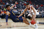 Stanford's Oscar da Silva, right, fouls California's Andre Kelly during the second half of an NCAA college basketball game in the first round of the Pac-12 men's tournament Wednesday, March 11, 2020, in Las Vegas. (AP Photo/John Locher)