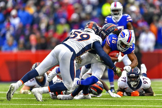 Buffalo Bills wide receiver Andre Roberts (18) is tackled by the Denver Broncos during the third quarter of an NFL football game, Sunday, Nov. 24, 2019, in Orchard Park, N.Y. (AP Photo/Adrian Kraus)