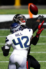 Atlanta Falcons wide receiver Julio Jones (11) prepares to make a catch against Seattle Seahawks safety Lano Hill (42) during the second half of an NFL football game, Sunday, Sept. 13, 2020, in Atlanta. (AP Photo/Brynn Anderson)