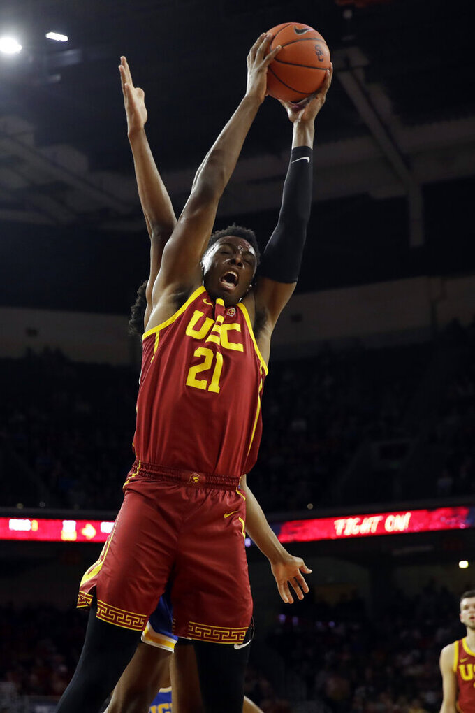 Southern California forward Onyeka Okongwu (21) grabs a rebound during the first half of an NCAA college basketball game against UCLA Saturday, March 7, 2020, in Los Angeles. (AP Photo/Marcio Jose Sanchez)