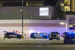 Police line the parking lot outside the Oneida Casino in the early morning hours of Sunday, May 2nd, 2021, near Green Bay, Wisconsin. Authorities in Wisconsin say a gunman killed two people at a Green Bay casino restaurant and seriously wounded a third before he was shot and killed by police Saturday. (AP Photo/Mike Roemer)