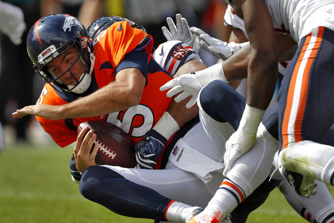Denver Broncos quarterback Joe Flacco (5) is sacked by Chicago Bears outside linebacker Khalil Mack during the first half of an NFL football game, Sunday, Sept. 15, 2019, in Denver. (AP Photo/David Zalubowski)