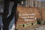 Spanish graffiti declares: I met love at the road blocks. Jeancarlo,