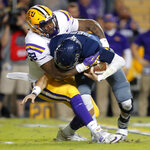 LSU defensive end Neil Farrell Jr. (92) sacks Rice quarterback Shawn Stankavage (3) in the first half of an NCAA college football game in Baton Rouge, La., Saturday, Nov. 17, 2018. (AP Photo/Gerald Herbert)