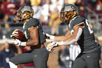 Minnesota wide receiver Seth Green, left, celebrates with teammate Brevyn Spann-Ford, right, after making a touchdown against Maryland during an NCAA college football game Saturday, Oct. 26, 2019, in Minneapolis. (AP Photo/Stacy Bengs)