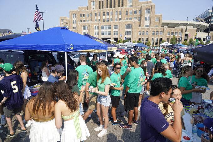 Fans tailgate before Toledo played Notre Dame in an NCAA college football game in South Bend, Ind., Saturday, Sept. 11, 2021. (AP Photo/AJ Mast)