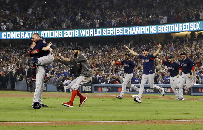 FILE - In this Oct. 28, 2018, file photo, the Boston Red Sox celebrate after Game 5 of baseball's World Series against the Los Angeles Dodgers in Los Angeles. The Red Sox won 5-1 to win the series 4 games to 1. (AP Photo/David J. Phillip)