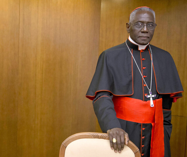 "Cardinal Robert Sarah, prefect of the Congregation for Divine Worship and the Discipline of the Sacraments, arrives for the presentation of Cardinal Raymond Leo Burke's book Divine Love Made Flesh, in Rome, Wednesday, Oct. 14, 2015. The Vatican said Saturday it was ""necessary and urgent"" to return to in-person Masses as soon as coronavirus lockdowns permit. (AP Photo/Andrew Medichini)"
