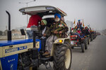 A retired soldier participates in a farmers tractor rally in a protest against new farm laws at Ghaziabad, outskirts of New Delhi, India, Thursday, Jan. 7, 2021. Indian farmers who have blockaded key highways for weeks say they'll continue their protests for new agricultural laws to be repealed. (AP Photo/Altaf Qadri)