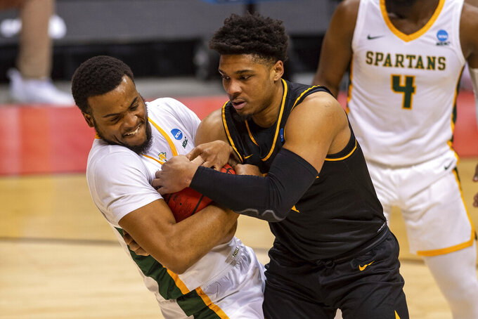 Norfolk State forward J.J. Matthews (15), left, and Appalachian State guard Justin Forrest (1) battle for the ball during the first half of a First Four game in the NCAA men's college basketball tournament, Thursday, March 18, 2021, in Bloomington, Ind. (AP Photo/Doug McSchooler)