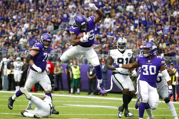 Minnesota Vikings running back Alexander Mattison (25) scores on a 10-yard touchdown run during the second half of an NFL football game against the Oakland Raiders, Sunday, Sept. 22, 2019, in Minneapolis. (AP Photo/Bruce Kluckhohn)
